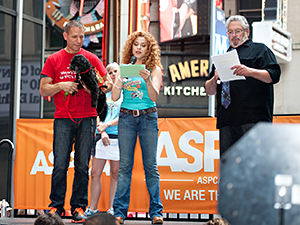 Mayor's Alliance for NYC's Animals Wheel of Hope driver, Joe Galka, presents a dog for adoption with Bernadette Peters and Harvey Fierstein at Broadway Barks 15 on July 13, 2013. (Photo by Geoffrey Tischman)