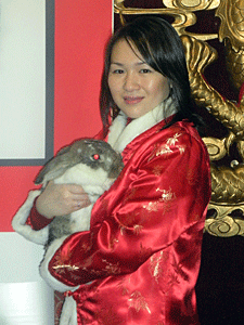 Helen Chen, Rabbit Rescue & Rehab/AC&C volunteer, holding an adoptable rabbit from Animal Care & Control of NYC (AC&C).