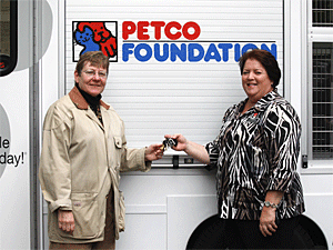 The Petco Foundation's Susan Rosenberg, National Grants and Disaster Relief Manager, presents Mayor's Alliance President Jane Hoffman with the keys to the brand new pet adoption van. (Photo by Jenna Leigh Teti)