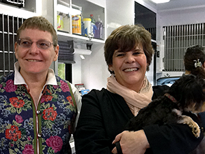 President of the Mayor's Alliance for NYC's Animals, Jane Hoffman, and Principal Mary McDonnell show off two-year-old Yorkie, Oona. (Photo by Mayor's Alliance for NYC's Animals)