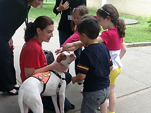 Barbra Tolan from the Mayor's Alliance for NYC's Animals introduces pre-K students at P.S. 209 in Whitestone, Queens, to one-and-a-half-year-old Pit Bull, Charlie. (Photo by Mayor's Alliance for NYC's Animals)