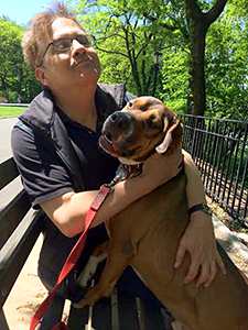 Waggin' Train Rescue adoptee, Alfie, enjoys a summer day in Riverside Park with his adopter, Ken. (Photo by Jane Kleinsinger)
