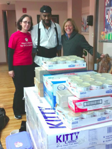 Urban Resource Institute shelter employee, Junior Pilgrim, accepts URIPALS pet supplies and equipment from Jenny Coffey and Debbie Fierro from the Mayor's Alliance for NYC's Animals on November 10. (Photo by Ann Michitsch)