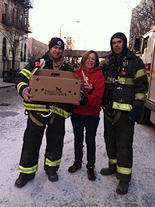 Mayor's Alliance for NYC's Animals staff, Debbie Fierro (shown) and Jenny Coffey, were assisted by FDNY firefighters in rescuing cats and other pets stranded in apartments near the East Harlem explosion site. (Photo by Jenny Coffey)