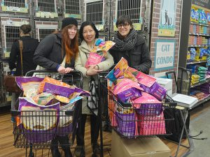 Certified TNR Caretakers and rescue group representatives picked up the bags of Halo Spot's Stew so generiously shared by KittyKind. (Photo by KittyKind)