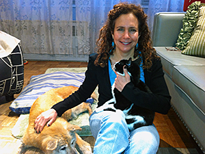 April Lang, LCSW, shown here with her dog Ruby and cat Hawkins, offers animal bereavement counseling and other therapy services. (Photo by Neil Sirni)