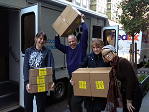 Mayor's Alliance for NYC's Animals staff members Maggie, Steve, Connie, and Diane load cases of food generously donated by Stella & Chewy's to distribute to pet owners in storm-damaged areas to help them continue to care for their animals. The Alliance adoption van temporarily joined our Wheels of Hope fleet to move animals and supplies during this crisis.